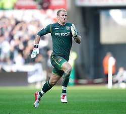 SWANSEA, WALES - Sunday, March 11, 2012: Manchester City's goalkeeper Joe Hart races back to prevent Swansea City scoring a second goal during the Premiership match at the Liberty Stadium. (Pic by David Rawcliffe/Propaganda)