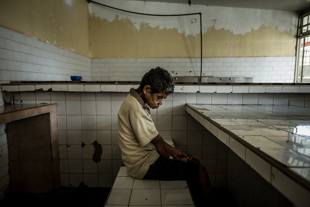 BARQUISIMETO, VENEZUELA - JULY 28, 2016:  Josefina Zapata, a patient diagnosed with psychosis and epilepsy, waits for dinner to be served in the dining hall of the women's ward.  She does not have 5 of the 6 medicines prescribed to her, and regularly suffers from epileptic seizures that would be avoided if she had all the medicines that she needs. The hospital staff regularly keep her in an isolation cell, on a mattress on the floor so that if she starts convulsing, she is less likely to hurt herself. The economic crisis that has left Venezuela with little hard currency has also severely affected its public health system, crippling hospitals like El Pampero Psychiatric Hospital by leaving it without the resources it needs to take care of patients living there, the majority of whom have been abandoned by their families and rely completely on the state to meet their basic needs. The hospital has not employed a psychiatrist for over two years. Drugs used to combat bipolar disorder, epilepsy, schizoaffective disorder and chronic anxiety are now in short supply, as are numerous sedatives and tranquilizers needed to care for patients. PHOTO: Meridith Kohut for The New York Times