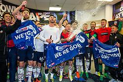 Free to use courtesy of Sky Bet - Jay Spearing sprays the champagne as Bolton Wanderers celebrate in the dressing room after finishing the season as Sky Bet League One runners up to secure automatic Promotion to the 2017/18 Sky Bet Championship - Rogan Thomson/JMP - 30/04/2017 - FOOTBALL - Macron Stadium - Bolton, England - Bolton Wanderers v Peterborough United - EFL Sky Bet League One.