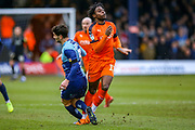 Wycombe Wanderers defender Joe Jacobson tangles feet with Luton Town midfielder Pelly-Ruddock Mpanzu during the EFL Sky Bet League 1 match between Luton Town and Wycombe Wanderers at Kenilworth Road, Luton, England on 9 February 2019.