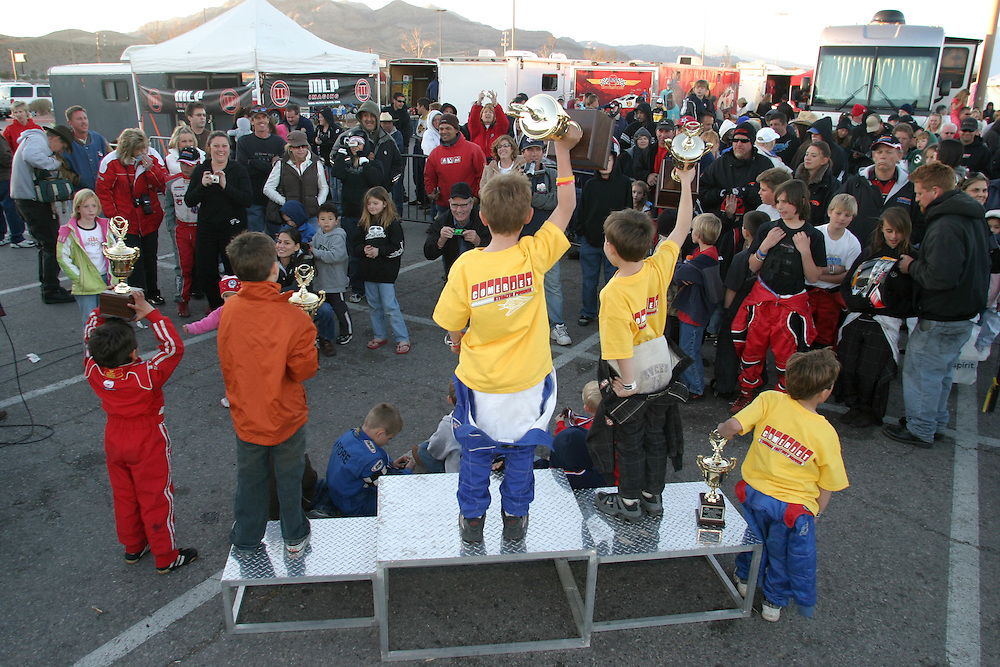 Royal  Mckee (7) the winner of the International Karting Federation race in Primm Nevada standing on top of the podium with his other rinds Braden Johnson (on his right) and Brendean Baker (on his left)..Show the happy parents the new trophies that they got after winning in the International Karting Federation race in Primm Nevada Saturday march 3 .2007......