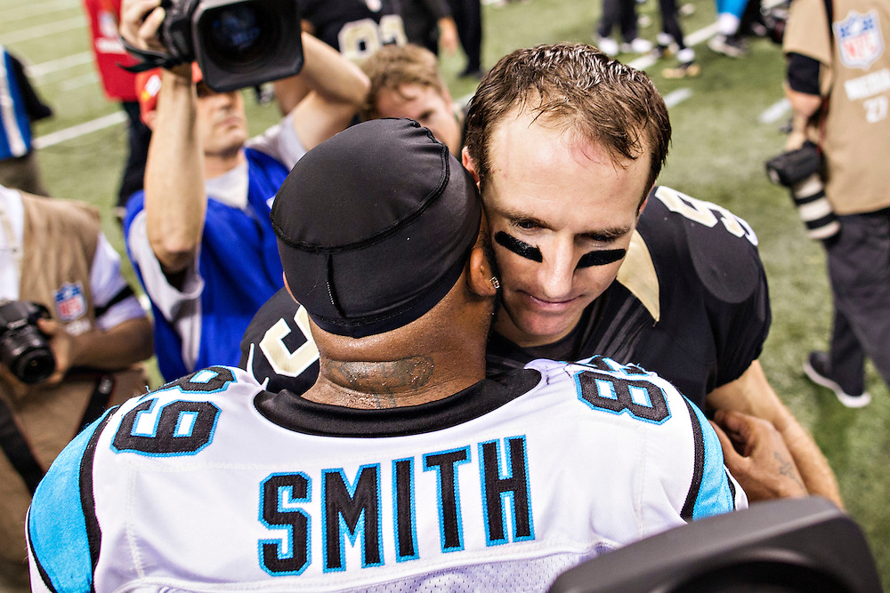 NEW ORLEANS, LA - DECEMBER 8:  Drew Brees #9 of the New Orleans Saints talks after the game with Steve Smith #89 of the Carolina Panthers at Mercedes-Benz Superdome on December 8, 2013 in New Orleans, Louisiana.  The Saints defeated the Panthers 31-13.  (Photo by Wesley Hitt/Getty Images) *** Local Caption *** Drew Brees; Steve Smith