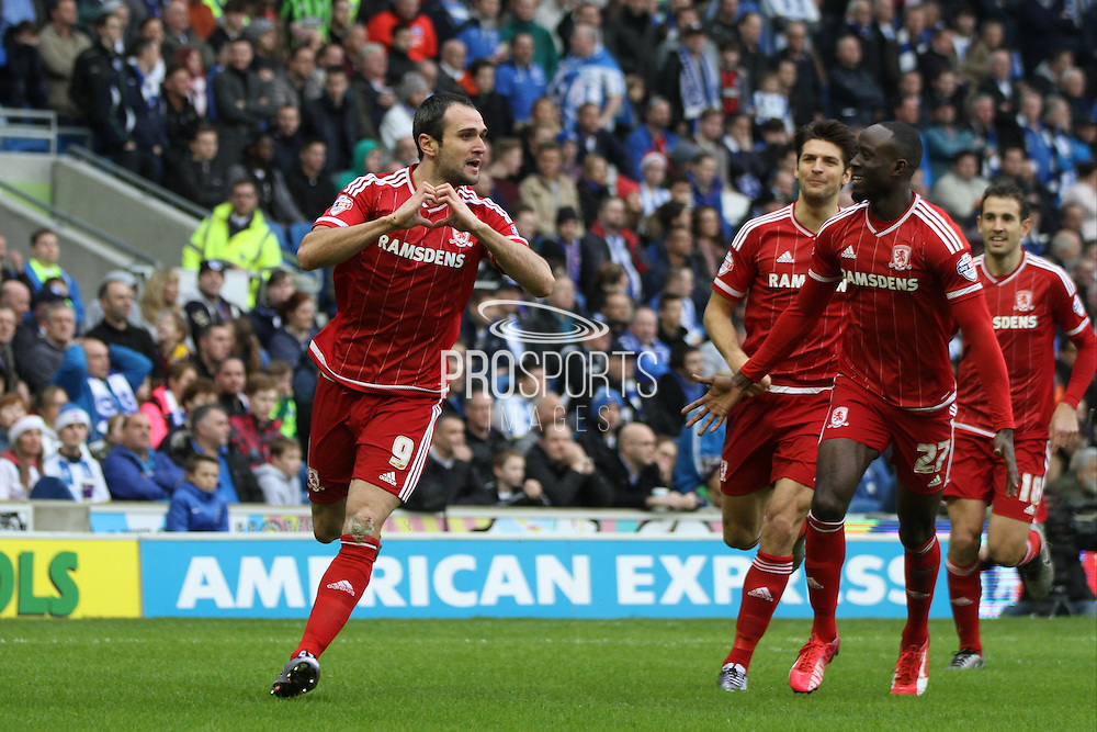 Middlesbrough FC striker Kike celebrates after scoring the first goal  during the Sky Bet Championship match between Brighton and Hove Albion and Middlesbrough at the American Express Community Stadium, Brighton and Hove, England on 19 December 2015. Photo by Geoff Penn.