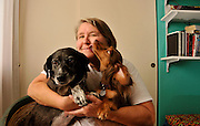 A uninsured senior patient afflicted with polycystic kidney disease, a chronic illness requiring medication and medical treatment, struggles with medical bills.  Her pets provide relief from stress.