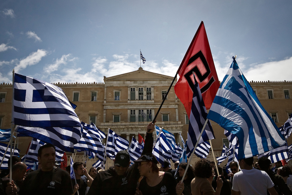 June 4th 2014, Athens, Greece - Members of the far-right party Golden Dawn, gathered outside of the Greek Parliament to show solidarity and protest for the release of the party's leader Nikos Michaloliakos as well as two other party deputies, Yiannis Lagos and Christos Pappas that were accused of criminal association, among others. Greece's judiciary had asked Greek parliament to lift the parliamentary immunity of Michaloliakos and two other party deputies, after criminal proceedings were launched against them.