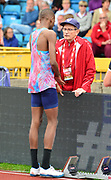 Mutaz Essa Barshim (QAT), left, talks with coach Stanislaw Szczyrba aka Stanley Szczyrba during the high jump at the Grand Prix Birmingham in an IAAF Diamond League meet at Alexander Stadium in Birmingham, United Kingdom on Sunday, August 20, 2017. (Jiro Mochizuki/Image of Sport)