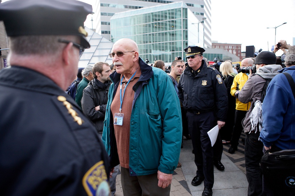 (20111205, Boston, Massachusetts)..Boston building inspector Charles Colburn, center, leaves talks with representatives of the Occupy Boston encampment who tried to negotiate the installation of a winterized, fire-retardant tent in the Dewey Square encampment in Boston, Massachusetts on Monday, December 5, 2011.  The protestors obeyed police orders and removed the tent from the premises...Photo by Brooks Canaday.