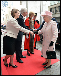 The Chairman of Lloyds of London John Nelson escorts HM The Queen and the Duke of Edinburgh into the  Lloyds of London building in the City of London, United Kingdom. Thursday, 27th March 2014. Picture by Andrew Parsons / i-Images