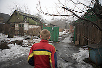 2009-02-07 Krasnoarmeisk, Ukraine. Kolja (13) lives alone in an empty house in Krasnoarmeisk. First his father died, later his mother too. They were addicted to alcohol and drugs. Kolja survives by staeling coal from railroad carriages. He sniffs glue to reduce the hunger. His 25 year old brother beats him up and steals his money whenever he drops by. To avoid getting trapped in his house with his brother he barricades the door of his house and enters and leaves through a small window. In winter most of his street friends have left to the Crimea where it's warmer. His only friends left are the nine year old Sascha and his dog Nadzieschka. Kolja's first dog was killed by his brother.