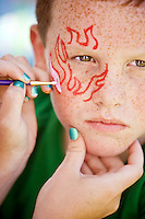 JEROME A. POLLOS/Press..Cody Drake has his face painted at Wednesday's safety fair at Coldwater Creek. About 300 School Plus students attended the event.