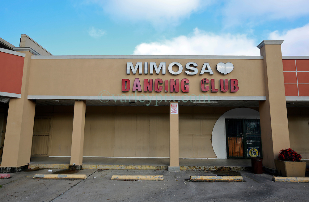 23 December 2013. New Orleans, Louisiana. <br /> The Mimosa Dancing Club in New Orleans East. <br /> <br /> The dancing club has been linked to BP claims in the media along with at least one homicide. <br /> <br /> N.B. There is no confirmation that the Mimosa club and officials from the BP Gulf Settlement program have any connection. For references please see links.<br /> <br /> Photo; Charlie Varley/varleypix.com<br /> <br /> Sources; <br /> <br /> https://www.thestateofthegulf.com<br /> <br /> http://theadvocate.com/home/7920317-125/2-top-officials-leave-bp<br /> <br /> http://www.theguardian.com/environment/2010/jun/20/deepwater-oil-spill-victims-compensation-bp<br /> <br /> http://www.news.com.au/finance/new-orleans-strip-club-mimosa-dancing-girls-files-oil-spill-compensation-claim/story-e6frfm1i-1225882007304