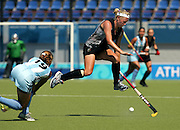 New Zealand Women's hockey captain Susie Muirhead leaps in the air in front of  Argentina's Marine Russo's (#19) shot. New Zealand lost to Argentina 3-0 played at the Olympic Hockey Centre, Athens, Greece, Friday August 20th, 2004.<br /> PHOTO: Andrew Cornaga/PHOTOSPORT