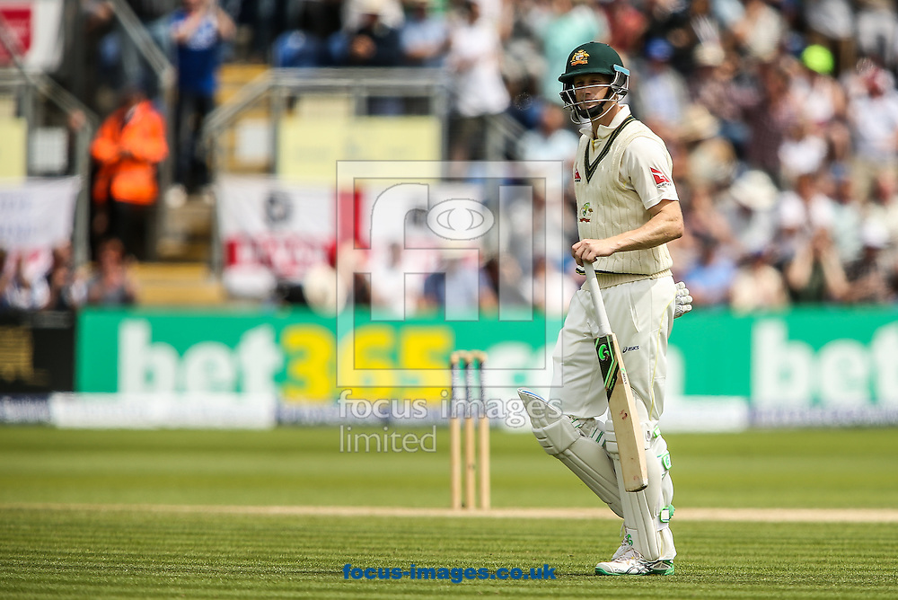 Adam Voges of Australia departs after being dismissed by Mark Wood of England (not shown) during the Investec Ashes Series Test Match at Sophia Gardens, Cardiff<br /> Picture by Andy Kearns/Focus Images Ltd 0781 864 4264<br /> 11/07/2015