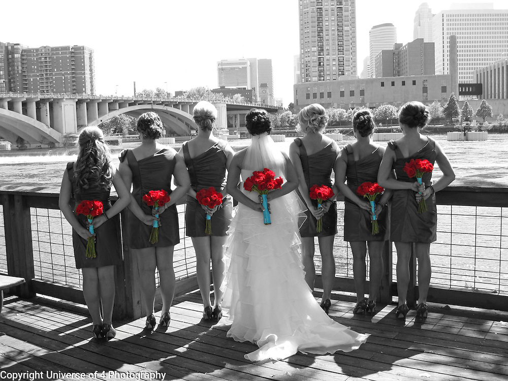 Highlight the details. This image was taken on the Mississippi River, with a metro setting as a backdrop.