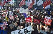 "People attend a protest demanding resignation of South Korean President Park Geun-hye near the presidential Blue House in Seoul, South Korea, Nov 19, 2016. About 1 million people attended a candlelight rally across South Korea on Saturday to demand resignation of President Park, whose longtime friend Choi Soon-sil and her close secretaries allegedly meddled in a variety of state affairs. Choi was arrested on charges of fraud and abuse of power early November, local media reported. President Park is suspected of having played a part in the corruption and influence-peddling scheme involving Choi and her key aides, prosecutors said on November 20, 2016 according to local media. Signs read,""Park Geun-hye resign"". Photo by Lee Jae-Won (SOUTH KOREA) www.leejaewonpix.com"