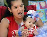 WARMINSTER, PA - MAY 26:  Gaby Handal holds Adriana Handal, 3 months old, of Warminster, Pennsylvania while they watch the Warminster Memorial Day Parade and Ceremony May 26, 2014 in Warminster, Pennsylvania. (Photo by William Thomas Cain/Cain Images)