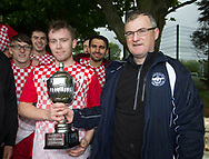Stobswell AFC captain Connor McMahon is presented with the Dundee Saturday Morning Football League second division championship trophy by league president Steve McSwiggan at University Grounds, Riverside<br /> <br /> <br />  - &copy; David Young - www.davidyoungphoto.co.uk - email: davidyoungphoto@gmail.com