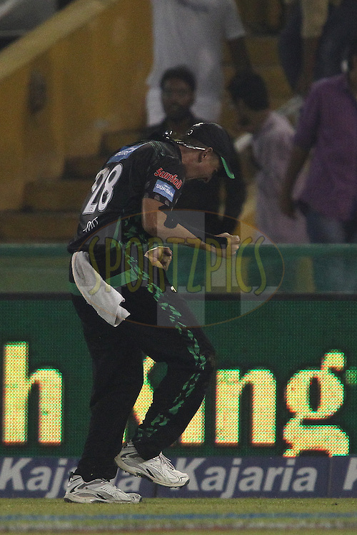 Daryn Smit of the Dolphins celebrates after taking the catch to get Sam Whiteman of the Perth Scorchers wicket during match 4 of the Oppo Champions League Twenty20 between the Dolphins and the Perth Scorchers held at the Punjab Cricket Association Stadium, Mohali, India on the 20th September 2014<br /> <br /> Photo by:  Shaun Roy / Sportzpics/ CLT20<br /> <br /> <br /> Image use is subject to the terms and conditions as laid out by the BCCI/ CLT20.  The terms and conditions can be downloaded here:<br /> <br /> http://sportzpics.photoshelter.com/gallery/CLT20-Image-Terms-and-Conditions-2014/G0000IfNJn535VPU/C0000QhhKadWcjYs