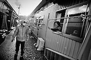 Local residents in their Temporary house in Taro Village, December 2011..In the north east of Japan there is a small city called Taro that was completely destroyed by the tsunami on the 3/11. After the tsunami the whole population of 8000 people moved to the top of the mountain where they settled down.  .Here they had temporary housing, temporary shops, a japanese warm bath and a temporary clinic provided by MSF. Almost one year later they are still living there, they have created their own new little community village and this has became the new reality for them. In this small colony you can find barber shops, restaurants, grocery stores, schools and a playground just like a normal village. The colony is not far from the sea so, as the majority of the population from Taro are fishermen, they don't find it too hard to survive in their new environment. From a temporary shelter this has became the new TARO Village.