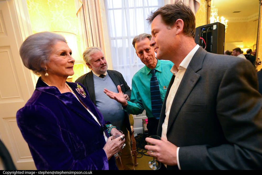 &Acirc;&copy; Licensed to London News Pictures. 11/09/2013. London, UK Nick Clegg (right) talks with April Ashley (Left) , MBE, a transgender model and restaurant hostess. Gary Everett (jumper) of Homotopia and human rights campaigner Peter Tatchell look on. The Deputy Prime Minister, Nick Clegg, hosts a reception at Admiralty House in Whitehall this evening, 11 September 2013, to celebrate the government&acirc;€™s progress in equal marriage. From next year gay people will be able to get married. A number of high profile guests including openly supportive celebrities, campaigners, religious figures and charities were in attendance.<br /> The London Gay Men Chorus Ensemble performed at the event. . Photo credit : Stephen Simpson/LNP
