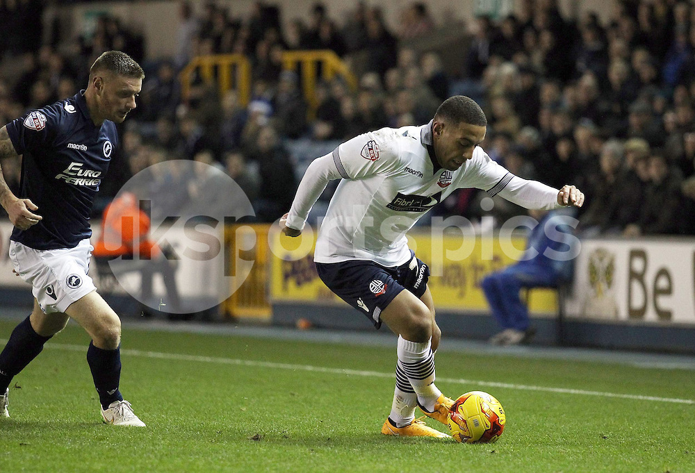 Liam Feeney of Bolton Wanderers and Andy Wilkinson of Millwall in action during the Sky Bet Championship match between Millwall and Bolton Wanderers at The Den, London, England on 19 December 2014. Photo by Edmund  Boyden.