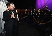 Sam Rockwell, left, and Leslie Bibb attend FOX 2018 Golden Globes After Party at The Beverly Hilton on Sunday, January 7, 2018, in Beverly Hills, Calif. (Photo by Jordan Strauss/JanuaryImages/Invision/AP)