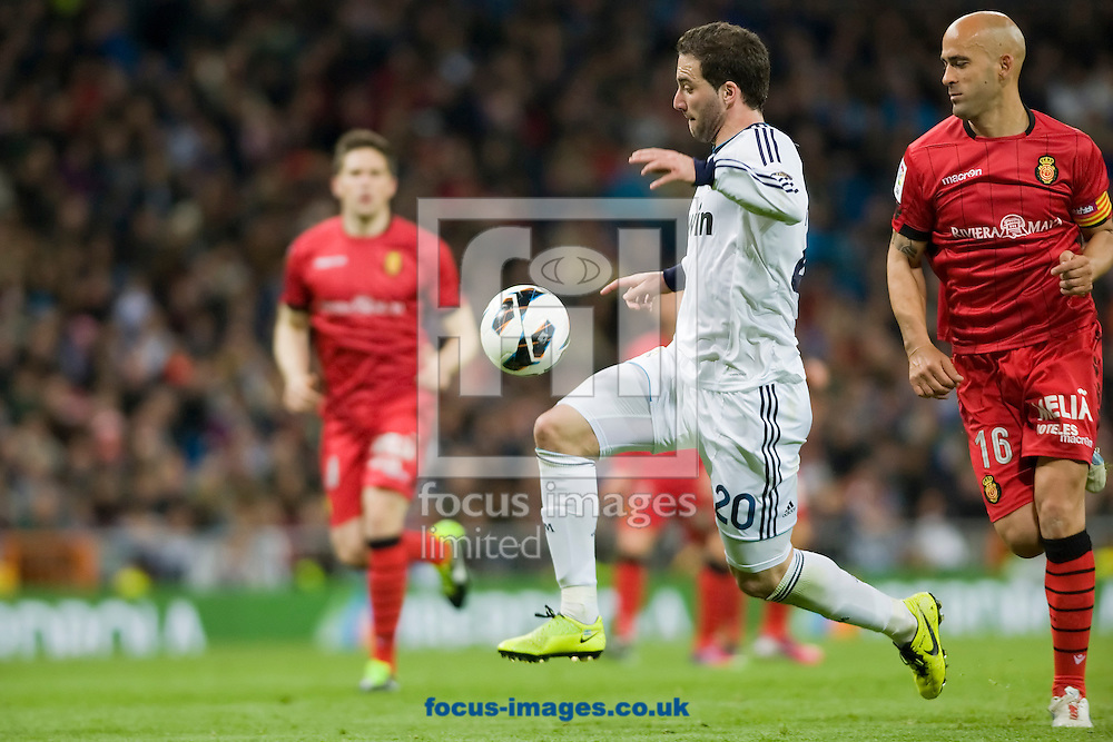Picture by Marcos Calvo Mesa/Focus Images Ltd +34 600474871.16/03/2013.Gonzalo Higuaín of Real Madrid (left) and Nunes of Real Club Deportivo Mallorca during the match at the Estadio Santiago Bernabéu, Chamartín. Liga BBVA.