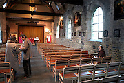 Belgium - Liege April 04, 2007, Women and priest speaking before a mass at St-Martin Basilica ©Jean-Michel Clajot