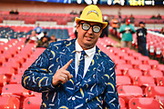 A Los Angeles Chargers fan in full Chargers suit , tie, hat and Glasses during the International Series match between Tennessee Titans and Los Angeles Chargers at Wembley Stadium, London, England on 21 October 2018.