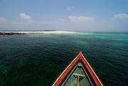 Wooden canoe  arriving to the beach at Chapera island. Las Perlas Archipelago, Panama province, Panama, Central America.