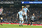 Kyle Walker wins the ball during the Premier League match between Manchester City and Newcastle United at the Etihad Stadium, Manchester, England on 20 January 2018. Photo by George Franks.