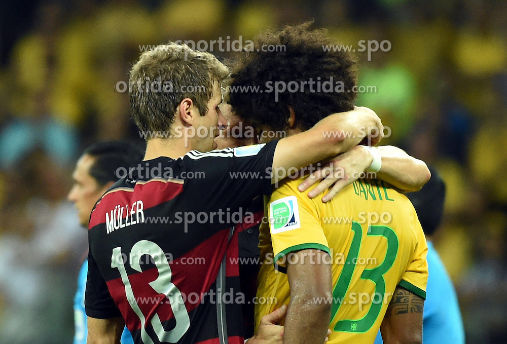08.07.2014, Mineirao, Belo Horizonte, BRA, FIFA WM, Brasilien vs Deutschland, Halbfinale, im Bild Brazil's Dante (R, front) is consoled by Germany's Thomas Muller (L, front) // during Semi Final match between Brasil and Germany of the FIFA Worldcup Brazil 2014 at the Mineirao in Belo Horizonte, Brazil on 2014/07/08. EXPA Pictures &copy; 2014, PhotoCredit: EXPA/ Photoshot/ Liu Dawei<br /> <br /> *****ATTENTION - for AUT, SLO, CRO, SRB, BIH, MAZ only*****