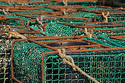 Fishing pots stacked in a fishing area of Ribadesella village, Asturias, Northern Spain, Spain