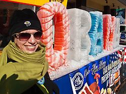 Karen in front of ice sculpture at Ben's Chili Bowl, U Street, Washington D.C., USA.