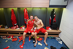 CARDIFF, WALES - Tuesday, October 13, 2015: Wales' Simon Church and Sam Vokes celebrate in the dressing room after the 2-0 victory over Andorra, and qualification for the finals, following the UEFA Euro 2016 qualifying Group B match at the Cardiff City Stadium. (Pic by David Rawcliffe/Propaganda)