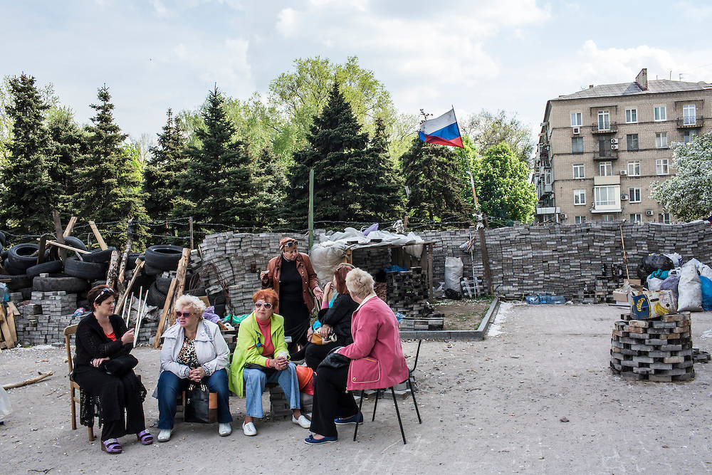 DONETSK, UKRAINE - MAY 4: Women sit next to barricades outside the regional administration building, which is occupied by pro-Russian protesters, on May 4, 2014 in Donetsk, Ukraine. Cities across Eastern Ukraine have been overtaken by pro-Russian protesters in recent weeks, leading the Ukrainian military to respond with force in some areas. (Photo by Brendan Hoffman for The Washington Post)