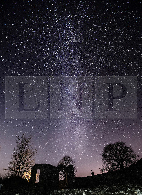 © London News Pictures. 02/01/2017. Aberystwyth, UK.<br /> On a cold clear and frosty night, with temperatures dropping to minus 5∫ celsius, the Milky Way is clearly seen as a thick band of stars across the skies above the ruins of the medieval Strata Florida (Ystrad Fflur) abbey in Pontrhydfendigaid, Ceredigion, mid Wales. Photo credit: Keith Morris/LNP