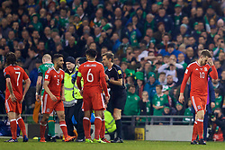 DUBLIN, REPUBLIC OF IRELAND - Friday, March 24, 2017: Wales' Neil Taylor walks off after being shown a red card and sent off against Republic of Ireland during the 2018 FIFA World Cup Qualifying Group D match at the Aviva Stadium. (Pic by David Rawcliffe/Propaganda)