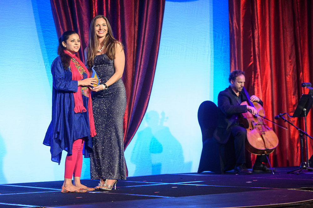 Amber Gell, rocket scientist from Lockheed Martin and NASA, presents Shawana Shah of Peshawar, Khyber Pakhtunkhwa, Pakistan, with one of the six Core Principle Awards, the Conviction award, at the fourth annual Muhammad Ali Humanitarian Awards Saturday, Sept. 17, 2016 at the Marriott Hotel in Louisville, Ky. (Photo by Brian Bohannon for the Muhammad Ali Center)