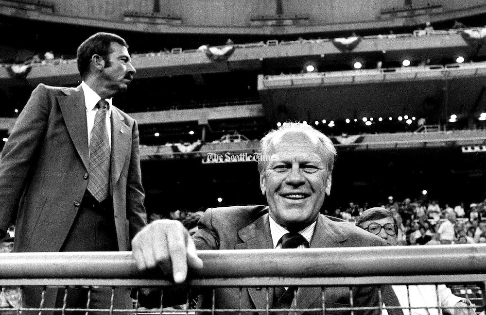 A Secret Service guard scanned the crowd as former President Gerald Ford watched the All-Star game from his box seat. (Vic Condiotty / The Seattle Times, 1979)