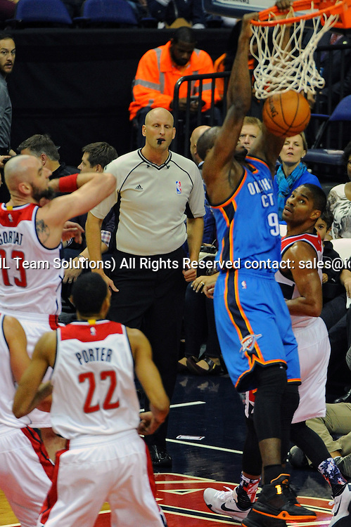 10 November 2015:  Oklahoma City Thunder forward Serge Ibaka (9) in action against Washington Wizards center Marcin Gortat (13) at the Verizon Center in Washington, D.C. where the Oklahoma City Thunder defeated the Washington Wizards, 125-101. (Photograph by Icon Sportswire)