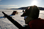 Canada Traditional Seal Hunting Threatened by Global Warming  ..Sasa Samson, age 37, the best Inuit hunter in the Inuit town of Resolute Bay, Canada, drives his snowmobile on the ice on the way to a Seal hunting expedition on Tuesday, June 12, 2007. Sasa hunts seals for food, and his community uses every part of the seals, either eating the meat or using the hides to make warm clothes. The traditional way of life in the Resolute Bay Inuit community is being threatened by rising temperatures. The dangers of global warming, which have been extensively documented by scientists, are appearing first, with rapid, drastic effects, in the Arctic regions where Inuit people make their home. Inuit communities, such as those living on Resolute Bay, have witnessed a wide variety of changes in their environment. The ice is melting sooner, depleting the seal population and leaving them unable to hunt the animals for as long. Other changes include seeing species of birds and insects (such as cockroaches and mosquitoes) which they have never encountered before. The Inuit actually lack words in their local languages to describe the creatures they have begun to see.  ..