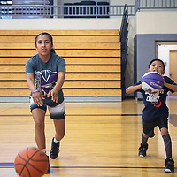 Miyamura Lady Patriots' Kaleia Vicenti, 15, left, and camper Preston Ukestine, 7, participate in passing drills Wednesday, July 17 at the Miyamura Lady Patriots Basketball Kiddie Camp in Gallup.