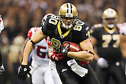 NEW ORLEANS, LA - DECEMBER 26:   Jimmy Graham #80 of the New Orleans Saints runs the ball after catching a pass against the Atlanta Falcons at Mercedes-Benz Superdome on December 26, 2011 in New Orleans, Louisiana.  The Saints defeated the Falcons 45-16.  (Photo by Wesley Hitt/Getty Images) *** Local Caption *** Jimmy Graham