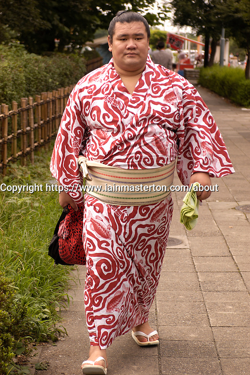Sumo wrestler in yukata walking on Tokyo street to a competition