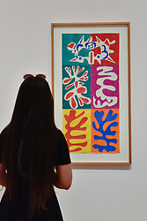 "© Licensed to London News Pictures. 01/08/2017. London, UK. A visitor views ""Panel with Mask"", 1947.  Preview of ""Matisse in the Studio"", at the Royal Academy of Arts, Piccadilly, the first exhibition to consider how the personal collection of treasured objects of Henri Matisse were both subject matter and inspiration for his work.  Around 35 objects are displayed alongside 65 of Matisse's paintings, sculptures, drawings, prints and cut-outs.  The exhibition runs 5 August to 12 November 2017.  Photo credit : Stephen Chung/LNP"