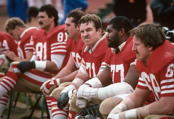 SAN FRANCISCO - JANUARY 6:  Keith Fahnhorst #71 of the San Francisco 49ers waits on the bench during the NFC Championship game against the Chicago Bears played on January 6, 1985 at Candlestick Park in San Francisco, California. (Photo by David Madison/Getty Images) *** Local Caption *** Keith Fahnhorst