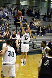 16 December 2006: Anthony Gunnell with an un-contested 3 point shot from the top of the key. The University of Chicago Maroons upset  the Illinois Wesleyan Titans 64 - 60 at the Shirk Center in Bloomington Illinois.<br />