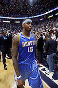Denver Nuggets forward Carmelo Anthony walks off the court following the the Utah Jazz 112-104 win in Game 6 of the NBA Western Conference first-round playoff series in Salt Lake City, Friday, April 30, 2010. (AP Photo/Colin E Braley)