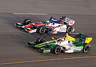 Simona De Slivestro (78) and Mike Conway (14) race side by side during the IZOD IndyCar Iowa Corn Indy 250 auto race at the Iowa Speedway in Newton, Iowa on Saturday, June 23, 2012.
